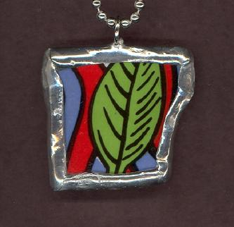 hand soldered bold graphic olive green leaf pendant
